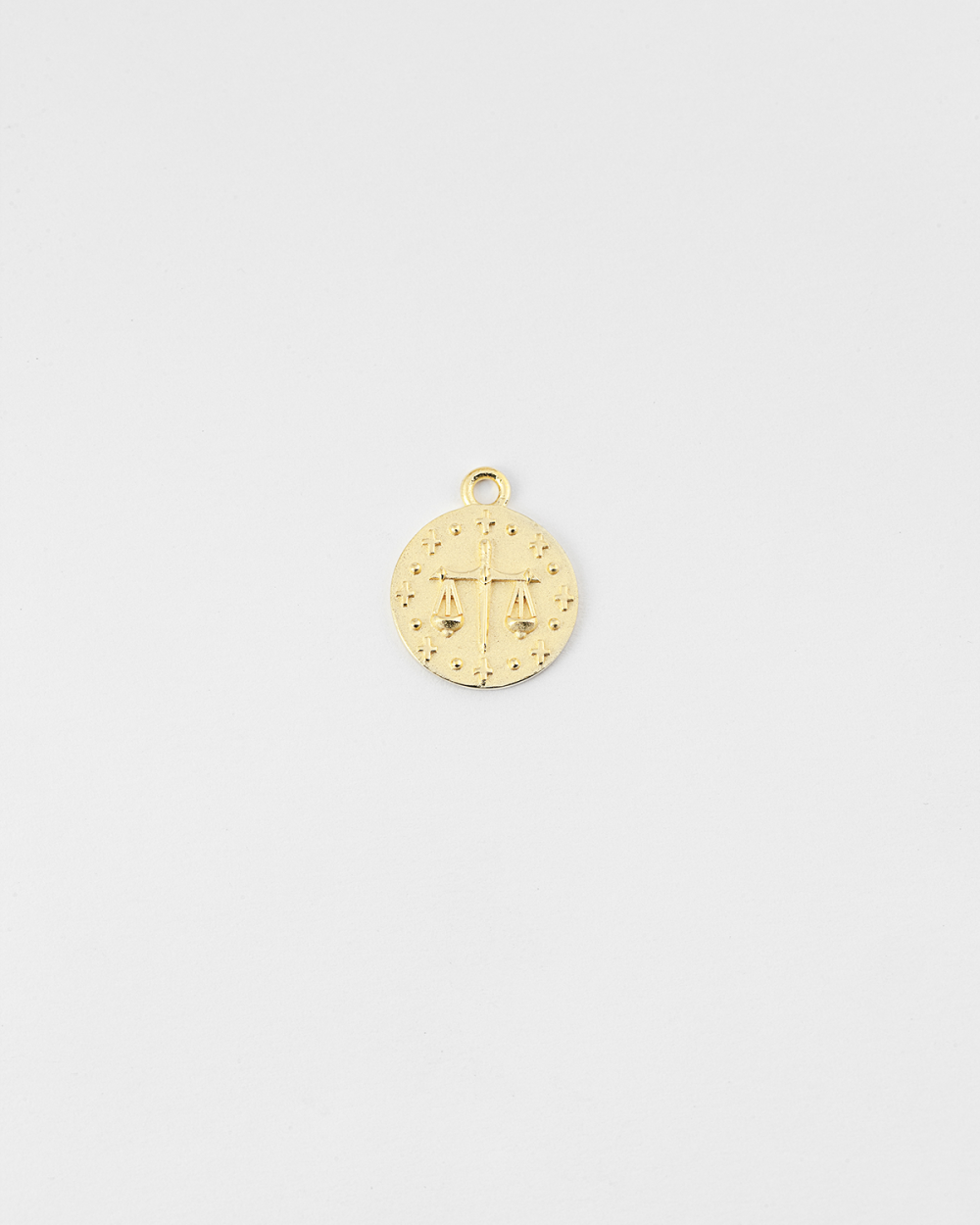 yellow gold justice charm