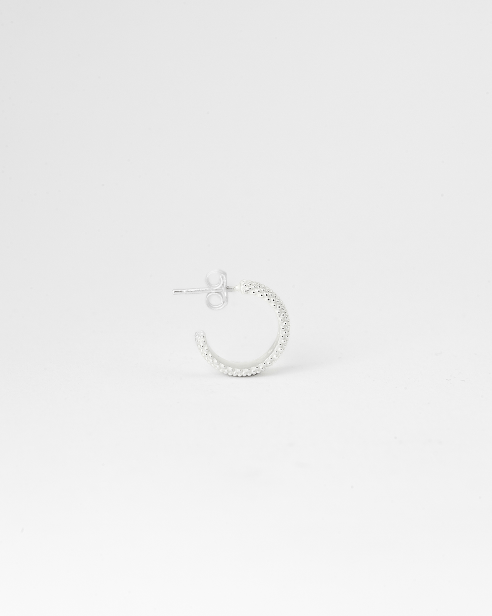 white dotted small hoop single earring