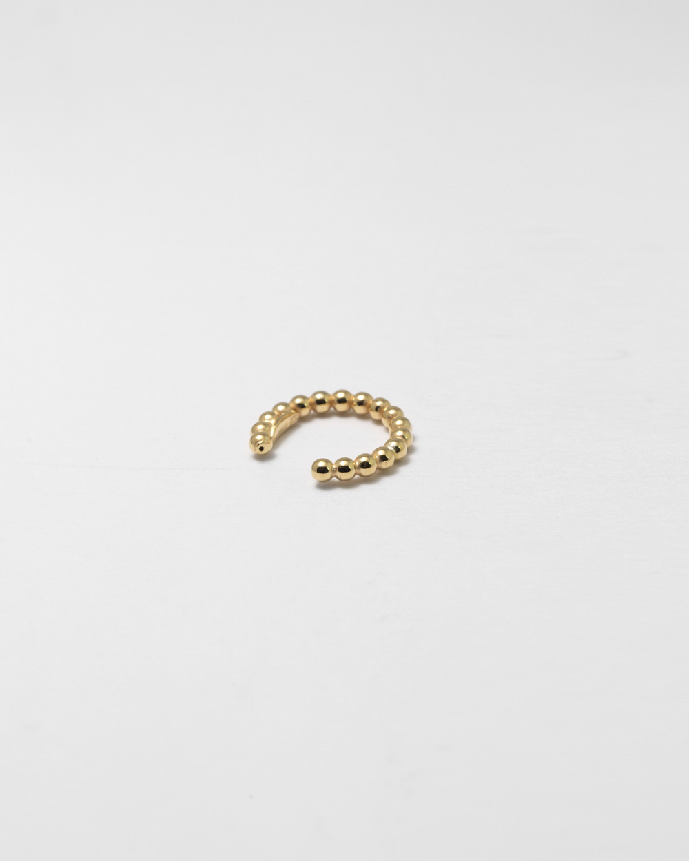 yellow gold bubbles single earcuff